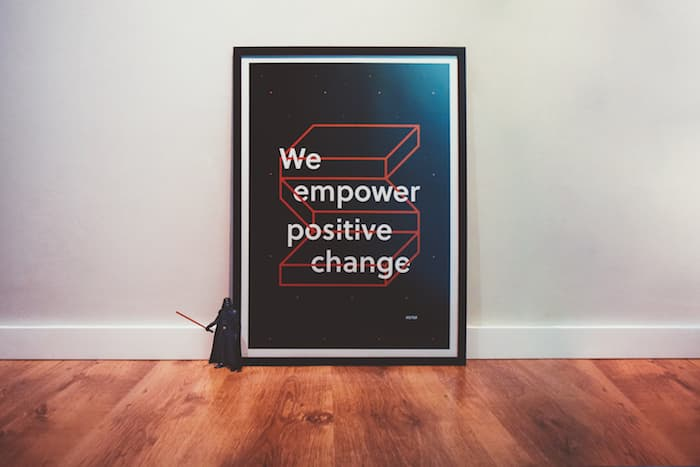Picture with our mantra and our symbol - We empower positive change