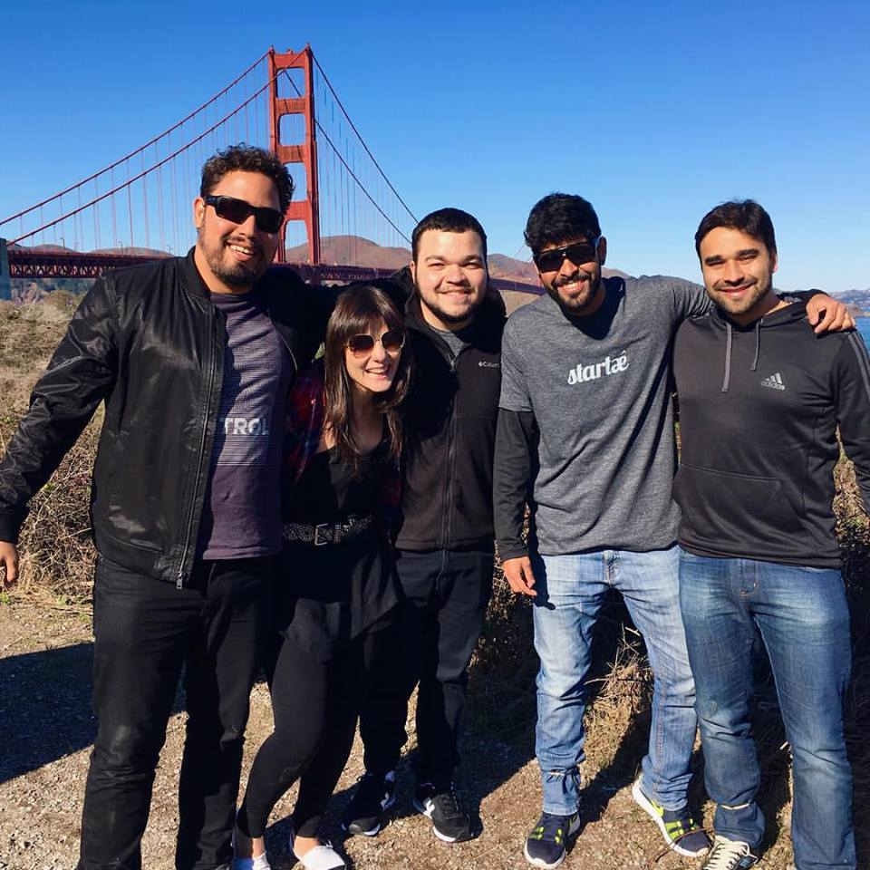 Team with the Golden Gate bridge behind
